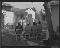 Bishop Cantwell providing confirmation at a tubercular rest home, La Puente, 1935