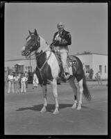 Governor Frank Merriam on horseback at the Pioneer Days parade, Santa Monica, 1935