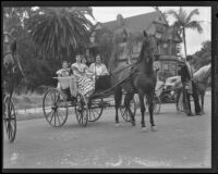 Carriage riders in historic dress at the Old Spanish Days Fiesta parade, Santa Barbara, 1935