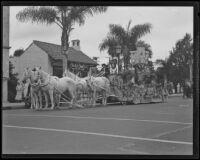 Horse-drawn float in the Old Spanish Days Fiesta parade on State Street, Santa Barbara, 1935