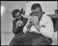 Richard Rankin, Fullerton Junior College Student, eats a giant hamburger as Helen Hay looks on, Fullerton, 1935