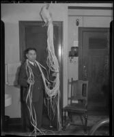 Soichi Ito with an Onagadori, long-tailed chicken, at the Olympic Hotel, Los Angeles, 1935