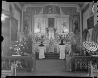 Father M. Thomas officiates at high mass at the Church of Nuestra Senora La Reina de Los Angeles in honor of Harry Carr, columnist, Los Angeles, 1936