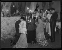 Mourners pray at a temporary altar at the Olvera Street memorial service for Harry Carr, Los Angeles, 1936