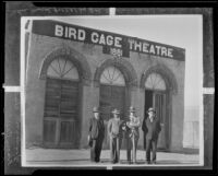 Harry Carr, Woodsworth Clum, Dr. C. G. Toland and the mayor in front of the Bird Cage Theatre, Tombstone, 1931