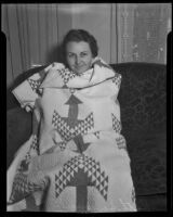 Ruth Sweeney draped in a quilt by Belle long, 1935