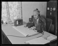 Floyd D. Young, meteorologist, broadcasting a frost report, Pomona, 1935