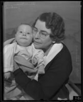 Oliver Goodrich, infant son of a County Jail inmate, with Chief Matron Vada Sullivan, Los Angeles, 1935