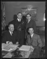 Frank Shaw, Florencio Avila Sanchez, James Davis and Ricardo Hill meet in Shaw's office to discuss a radio broadcast by President Cardenas of Mexico, Los Angeles, 1936
