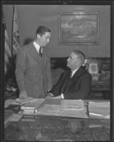 Frank Shaw and Florencio Avila Sanchez in Shaw's office to discuss a radio broadcast by President Cardenas of Mexico, Los Angeles, 1936