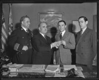 James Davis, Frank Shaw, Florencio Avila Sanchez and Ricardo Hill meet in Shaw's office to discuss a radio broadcast by President Cardenas of Mexico, Los Angeles, 1936