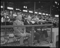 Oscar Reichow, Dave Fleming, and Bill Klepper watch a baseball game at Wrigley Field, Los Angeles, 1934