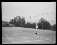 Helen Jacobs, tennis champion, on a tennis court, circa 1928