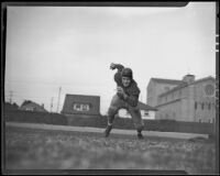 Gil Kuhn, center on the USC Trojans football team, running on a sports field at USC, Los Angeles, 1935