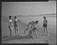 Mrs. W.R. Malcom, Elizabeth Scattergood, Mary McGeagh, Marcia Hammond, and Mrs. Calvin Wells Day (Esther Lynd Day Howard) play on the beach, Los Angeles, circa 1935