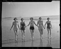 Mrs. W.R. Malcom, Elizabeth Scattergood, Mary McGeagh, Marcia Hammond, and Mrs. Calvin Wells Day (Esther Lynd Day Howard) walk on the beach, Los Angeles, circa 1935