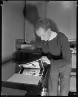 Photographer or technician manipulating photographs printed with images of Mickey Mouse, Los Angeles, 1935
