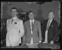 Attorney Arthur Verge with clients Frank Sebastian and Walter Pollock in court, Los Angeles, 1935
