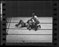 "Wrestling match between Joseph ""Jumping Joe"" Savoldi and Mayes McLain, Olympic Auditorium, Los Angeles, 1935"