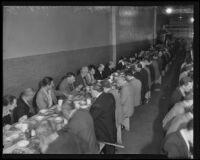 Men enjoy Thanksgiving dinner at the Midnight Mission, Los Angeles, 1935