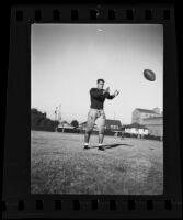 Bud Langley, USC football player, catching a football, Los Angeles, 1935