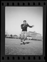 Bud Langley, USC football player, about to kick a football, Los Angeles, 1935