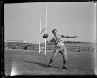 Bruins football player poised to throw a football at Spaulding Field at U.C.L.A., Los Angeles, 1932