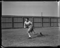 Bruins football player running with a football at Spaulding Field at U.C.L.A., Los Angeles, 1932