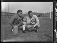 William H. Spaulding, U.C.L.A. football coach, with a football player Homer Oliver Spaulding Field at UCLA, Los Angeles, 1932