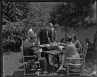 Jack and Ellen Morich serving lunch to members of the press covering the kidnapping of William F. Gettle, Beverly Hills, 1934