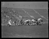 Football game between the UCLA Bruins and a Washington team at the Coliseum, Los Angeles