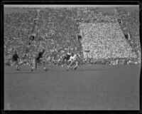 Football game between the UCLA Bruins and a Washington team at the Coliseum, Los Angeles, 1923-1939
