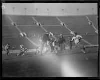 Football game between the Los Angeles Firemen and the Olympic Club at the Coliseum, 1931