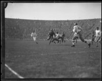 Football game between the USC Trojans and another team at the Coliseum, Los Angeles, 1923-1939
