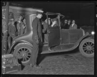 Police dusting for fingerprints in a Ford coup, possibly related to the Hickman kidnap and murder case, Los Angeles, 1927