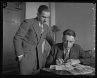 Dr. Benjamin Blank and Sergeant Howard L. Barlow analyze the fingerprints of William Edward Hickman, Los Angeles, 1928