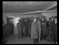 Men gathered inside of the Oregon police station where kidnapper and murderer William Edward Hickman was held, Pendleton, 1927