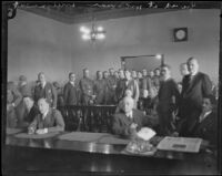 Officers stand guard at the arraignment of William Edward Hickman, kidnapper and murderer,Los Angeles, 1927