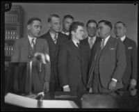 William Edward Hickman, kidnapper and murderer, with law enforcement officers, Los Angeles, 1927-1928