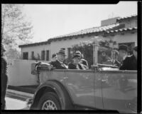 Herbert Hoover and Lou Henry Hoover riding in a convertible automobile with the top down, Los Angeles, 1932