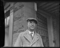 Upton Sinclair in an overcoat and cap, 1920-1939