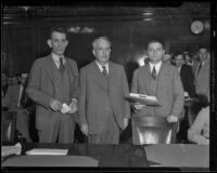Criminal attorneys John S. Cooper and M. G. Phillips with client Liberty A. Hill  in court, Los Angeles, 1932