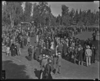 Attendees of the Iowa Picnic in Bixby Park stroll on the lawn, Long Beach, 1935