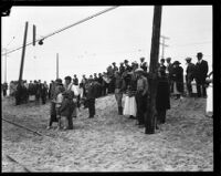 Spectators looking towards the charred remains of the Hope Development School for mentally disabled girls in Playa del Rey, Los Angeles, 1924