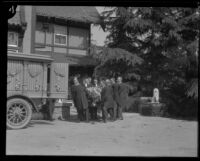 Pallbearers carry the coffin of Arthur Letts toward a funeral wagon at Holmby House, Los Angeles, 1923