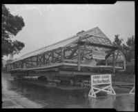 Greenhouse for the estate of Arthur Letts, Jr., as it is transported on a residential street, Los Angeles, circa 1927