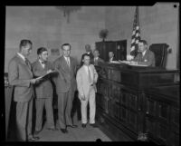 Leo P. Kelley, charged with murder, before a judge with attorney S. S. Hahn, Los Angeles, 1928