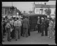 Police patrol car probably assigned to collect dance marathon participants at at Jack Kearns dance marathon, Los Angeles, probably 1934