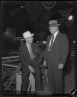Two men in an auditorium, filed with negative of boxing manager Jack Kearns