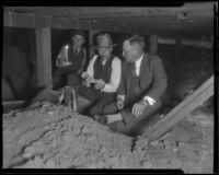 George Contreras, county investigator, and Asa Keyes, district attorney, at a crime scene in a basement, Los Angeles, 1924-1929